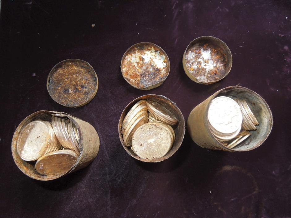 Cans containing 19th century gold coins is shown in this undated handout photo courtesy of Kagin's, Inc